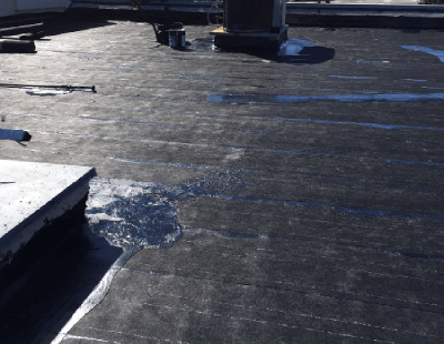 Applying Roofing Tar To Flat Roof